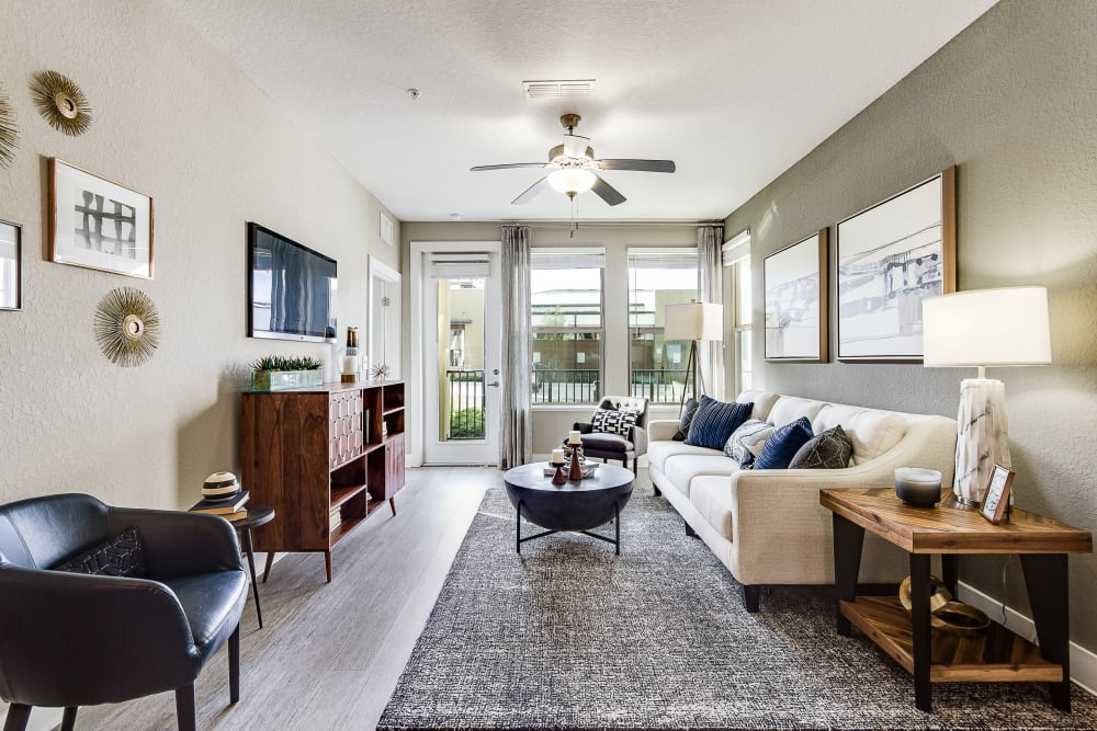 Living room with patio access at Steele Creek in Jacksonville, Florida