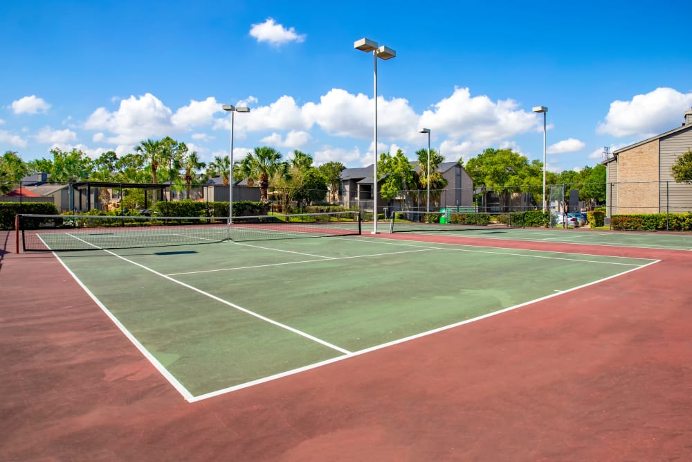 Play some tennis on the courts at 2400 Briarwest in Houston, Texas