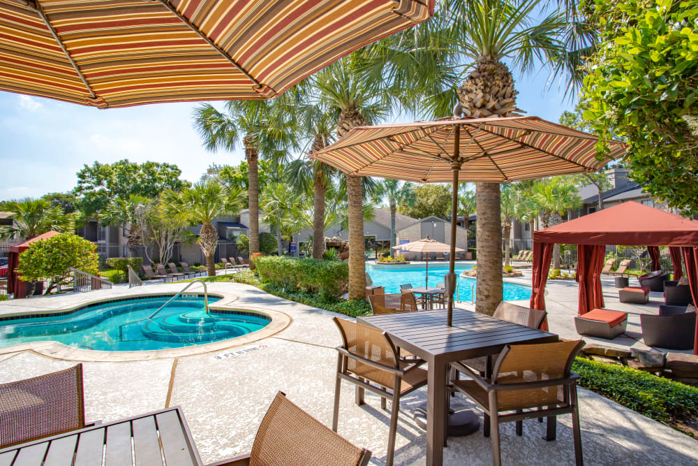 Enjoy the resort style pool with cabanas at 2400 Briarwest in Houston, Texas