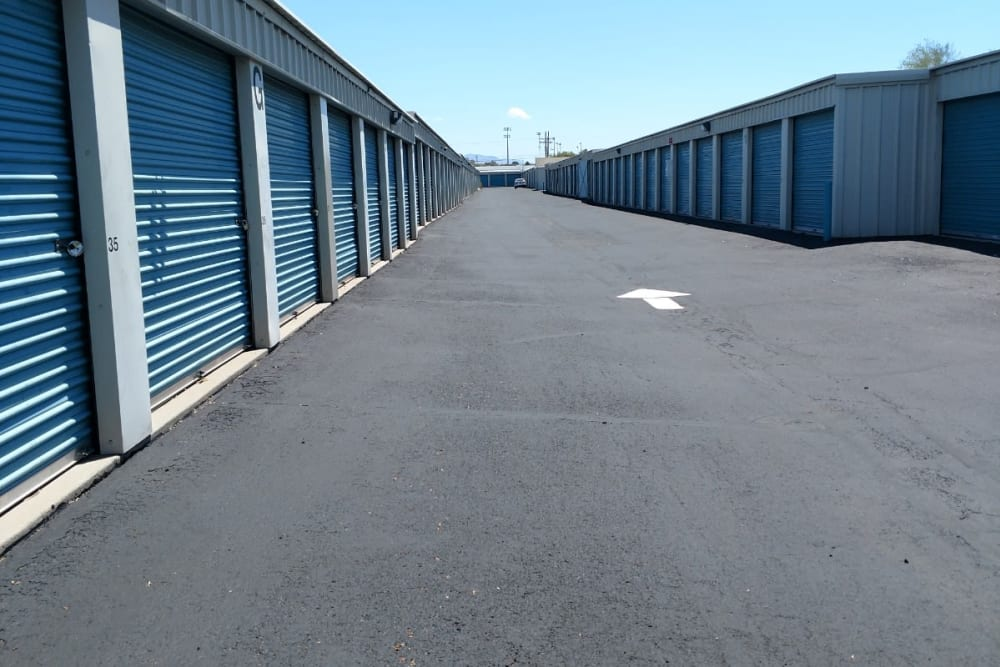 Driveway of outdoor storage units with roll up doors at StorQuest Self Storage in Tucson, AZ