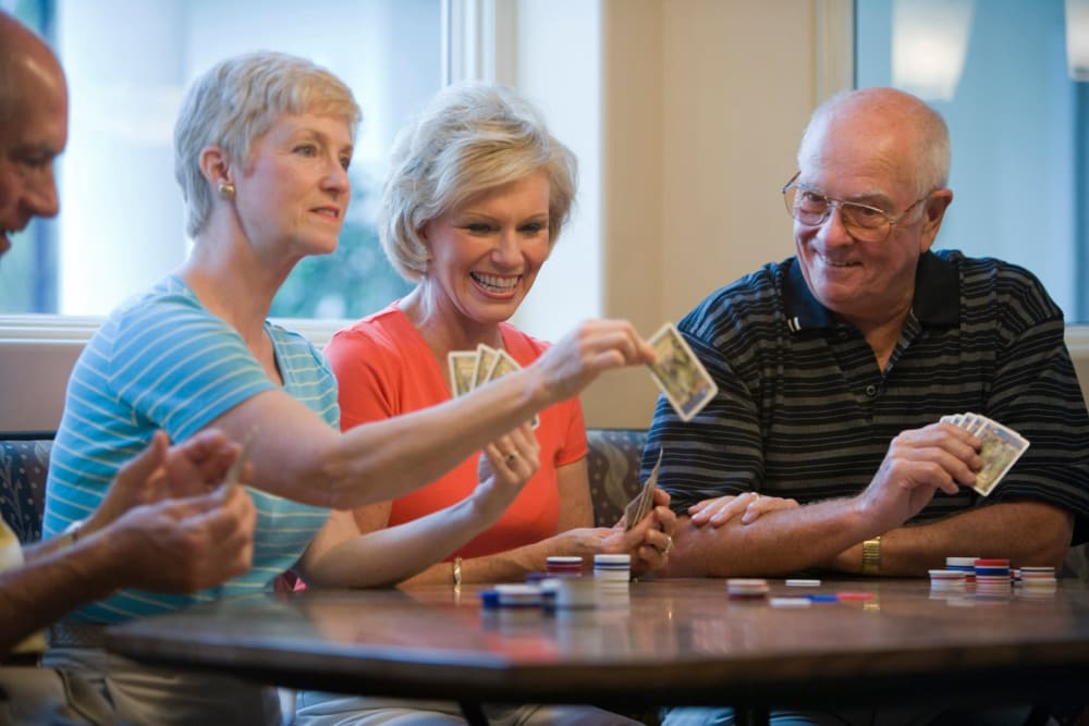 Residents playing a game of cards together at The Heights at Columbia Knoll in Portland, Oregon