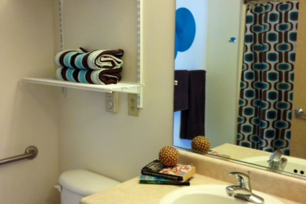 Clean bathrooms with large mirrors at The Heights at Columbia Knoll in Portland, Oregon