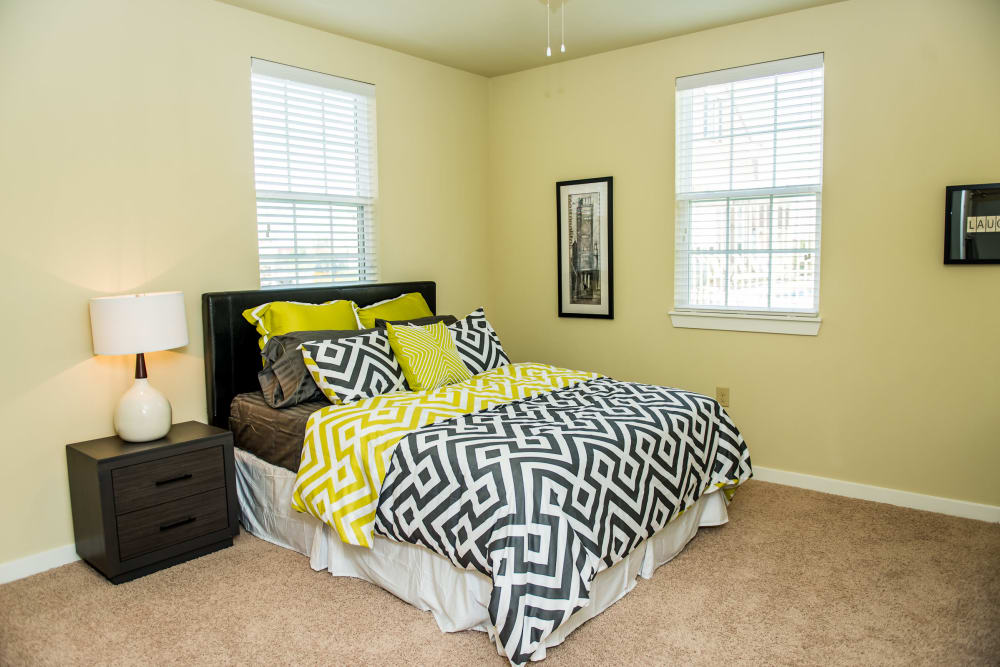 Well-lit bedroom at Traditions at Westmoore in Oklahoma City, Oklahoma.