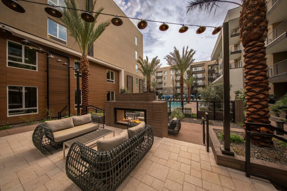 Comfortable seating around the fire pit near the pool area at Carter in Scottsdale, Arizona