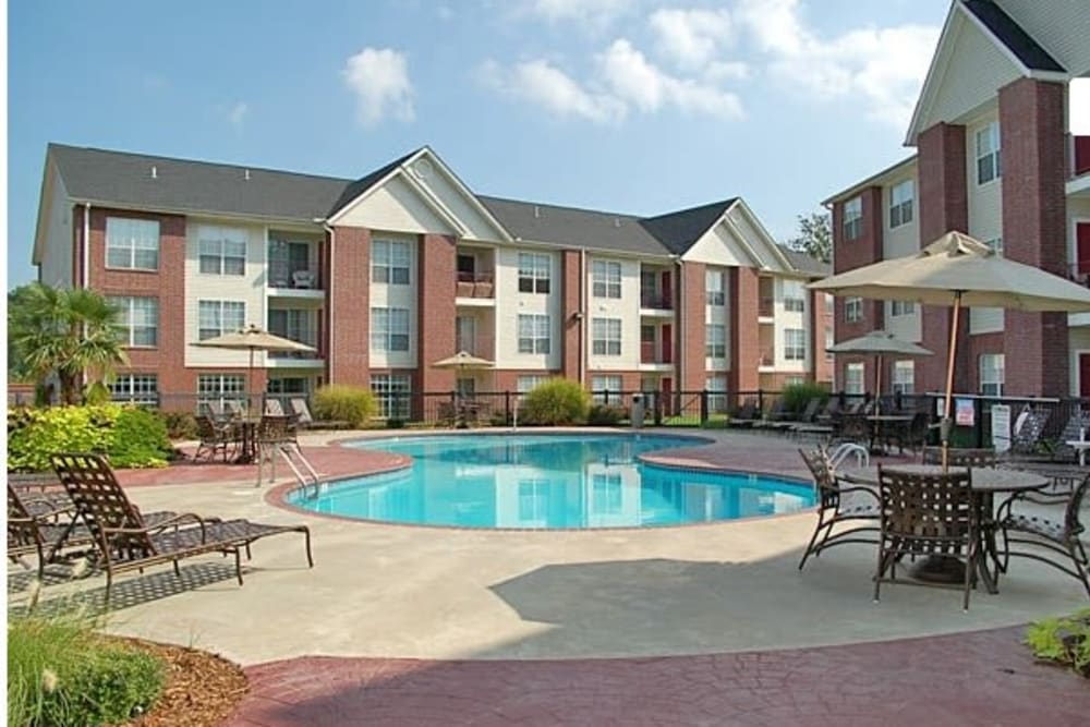 Resident pool with chairs at River Pointe in North Little Rock, Arkansas.