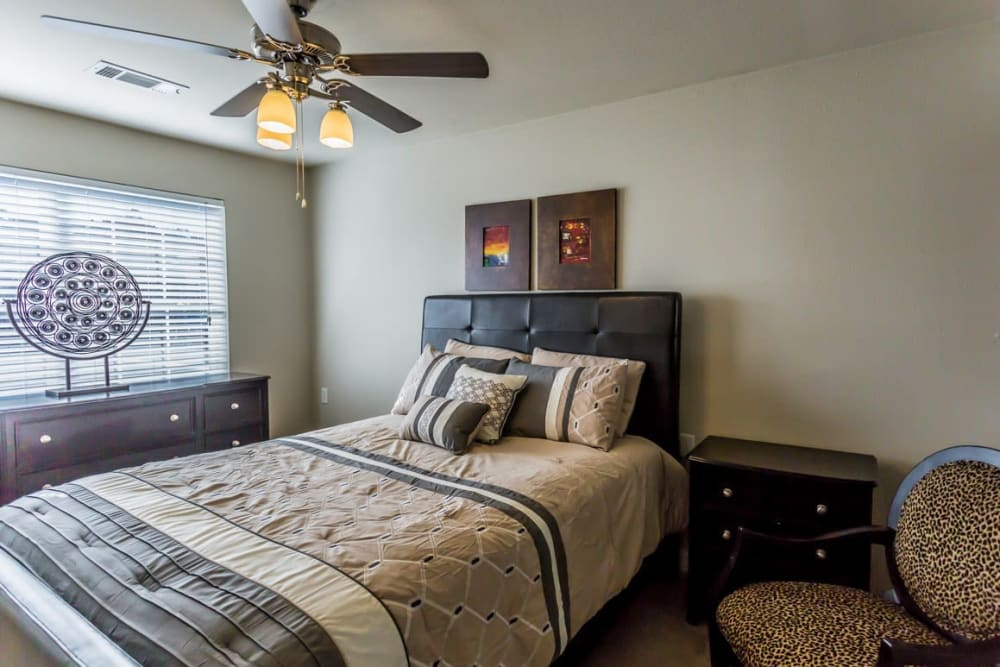 Bedroom with a large window at River Pointe in North Little Rock, Arkansas.