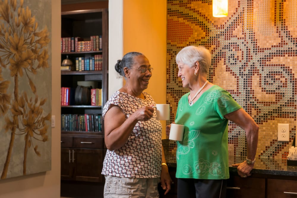 Residents socializing at Isle at Watercrest Bryan in Bryan, Texas