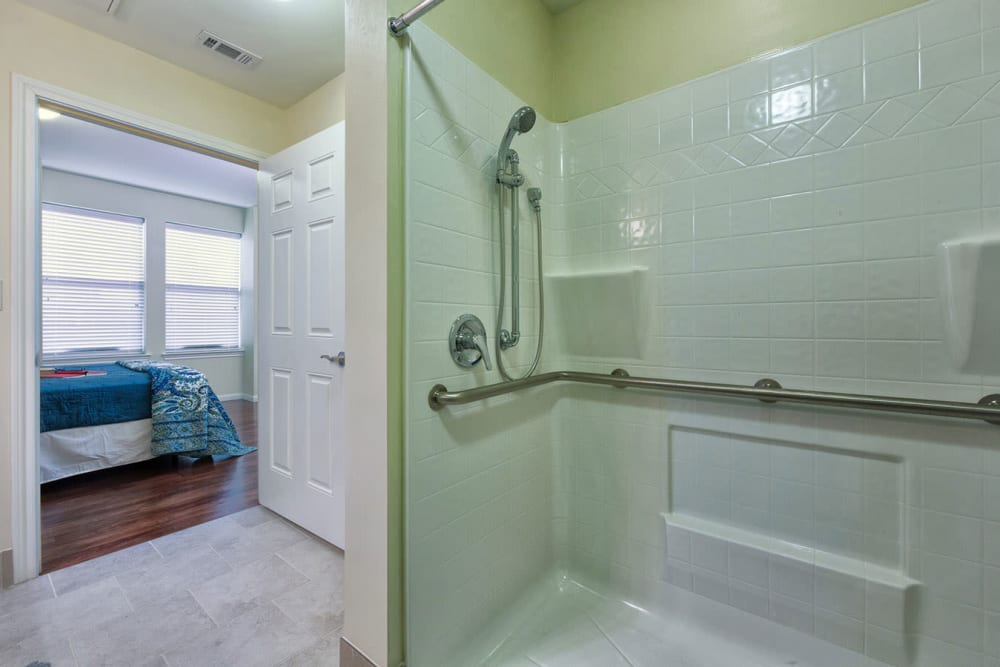 An apartment shower in the bathroom attached to the bedroom at The Village of the Heights in Houston, Texas