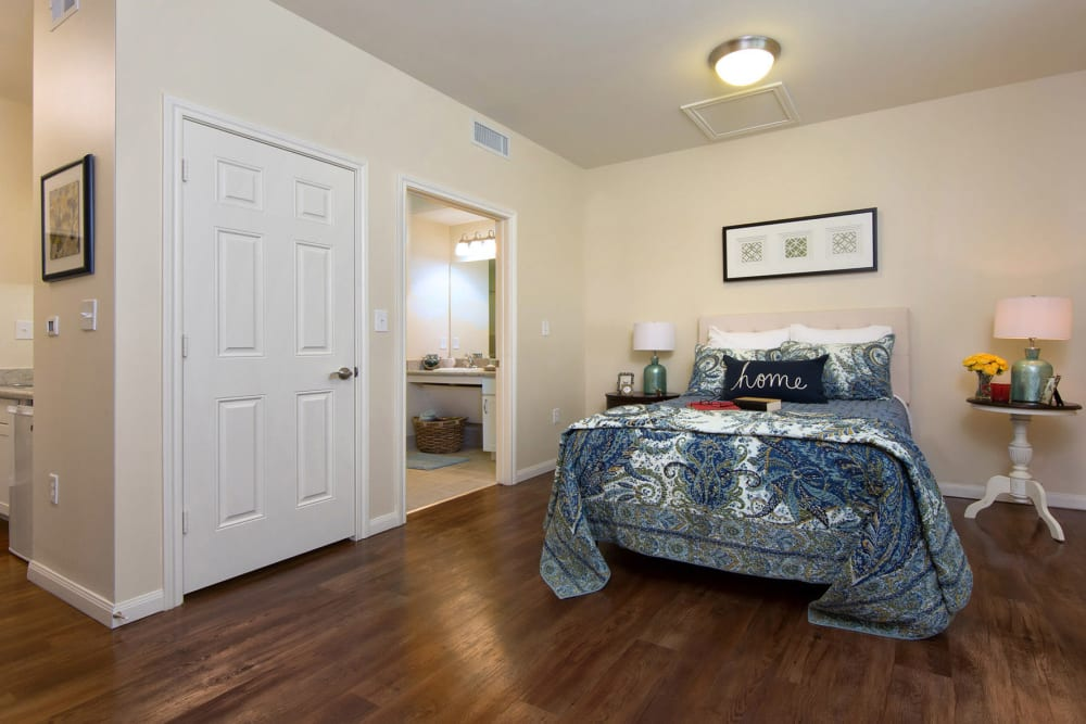 A spacious bedroom with wood flooring at The Village of the Heights in Houston, Texas