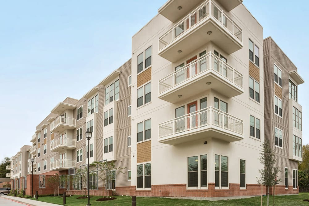 Apartment exterior and balconies at The Village of the Heights in Houston, Texas