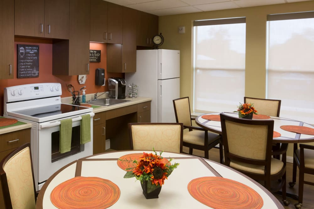 The community kitchen and dining room seating at The Village of the Heights in Houston, Texas