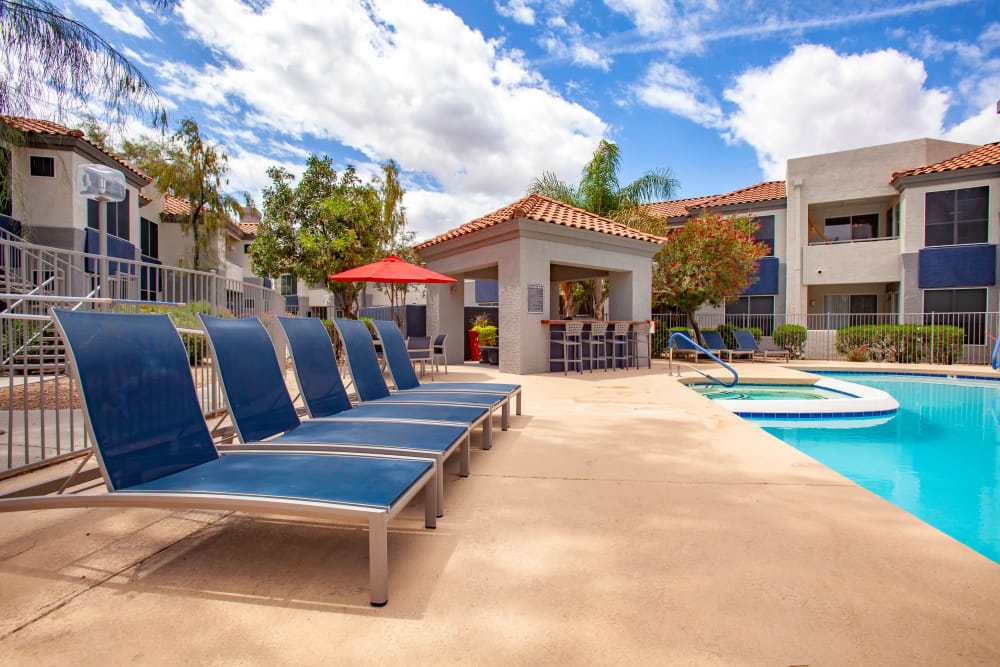 Lounge by the pool at our apartments in Phoenix, Arizona offer a Fitness Center