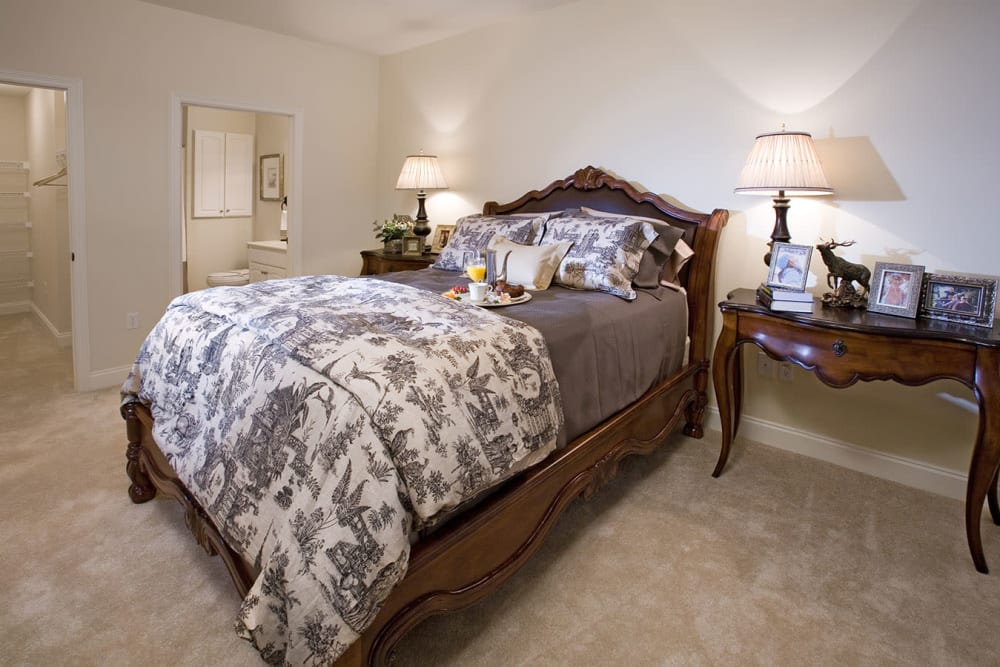 An apartment bedroom and bathroom at The Village of Tanglewood in Houston, Texas