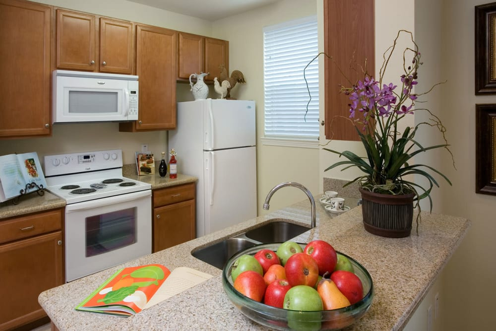 An apartment kitchen at The Village of Tanglewood in Houston, Texas