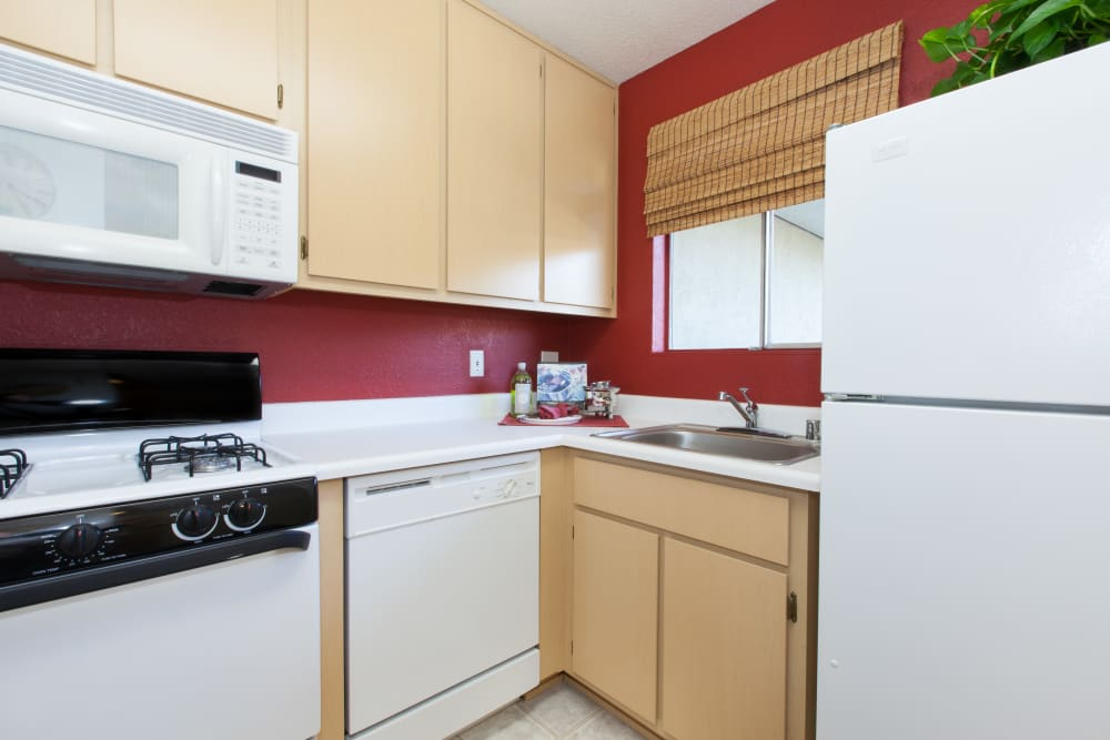 Fully equipped kitchen at Carrington Apartments in Fremont, California