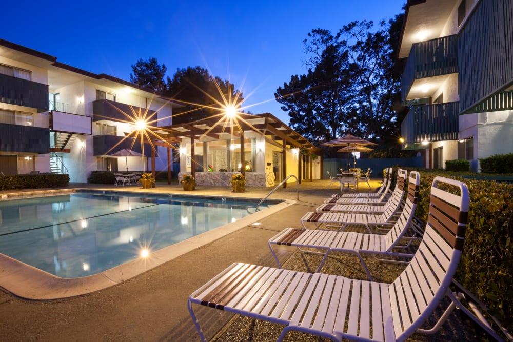 Poolside seating at Del Coronado Apartments in Alameda, California