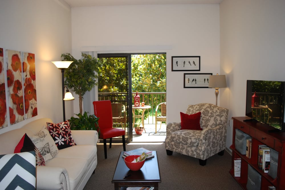 Well decorated living room with patio access at Pasadena Highlands in Pasadena, California
