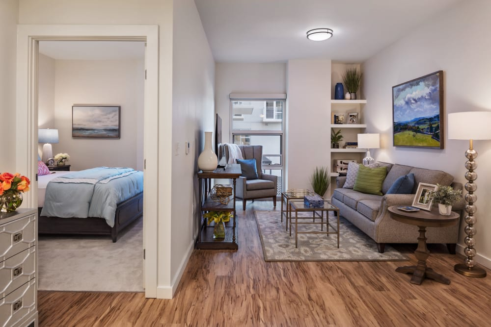 An apartment bedroom and living room at The Village at The Triangle in Austin, Texas