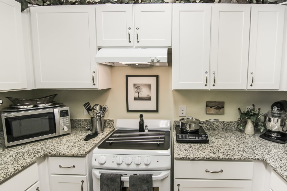 Granite counter tops in an apartment kitchen at Village on the Park Onion Creek in Austin, Texas