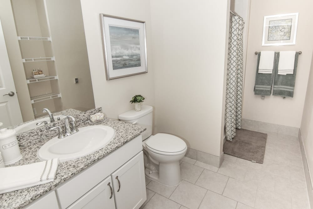 An apartment bathroom at Village on the Park Onion Creek in Austin, Texas
