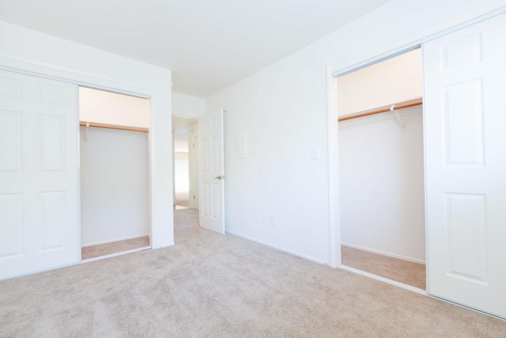 Master bedroom with plenty of closet space at The Glens Apartments in San Jose, California