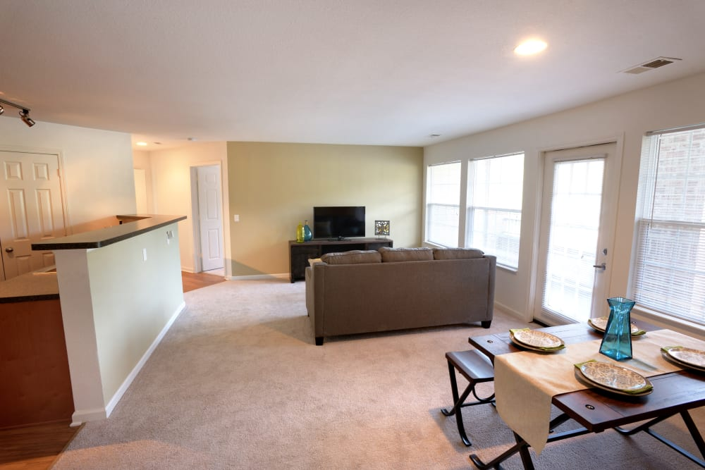 Living room and dining area at Cascade Falls Apartments in Akron, Ohio