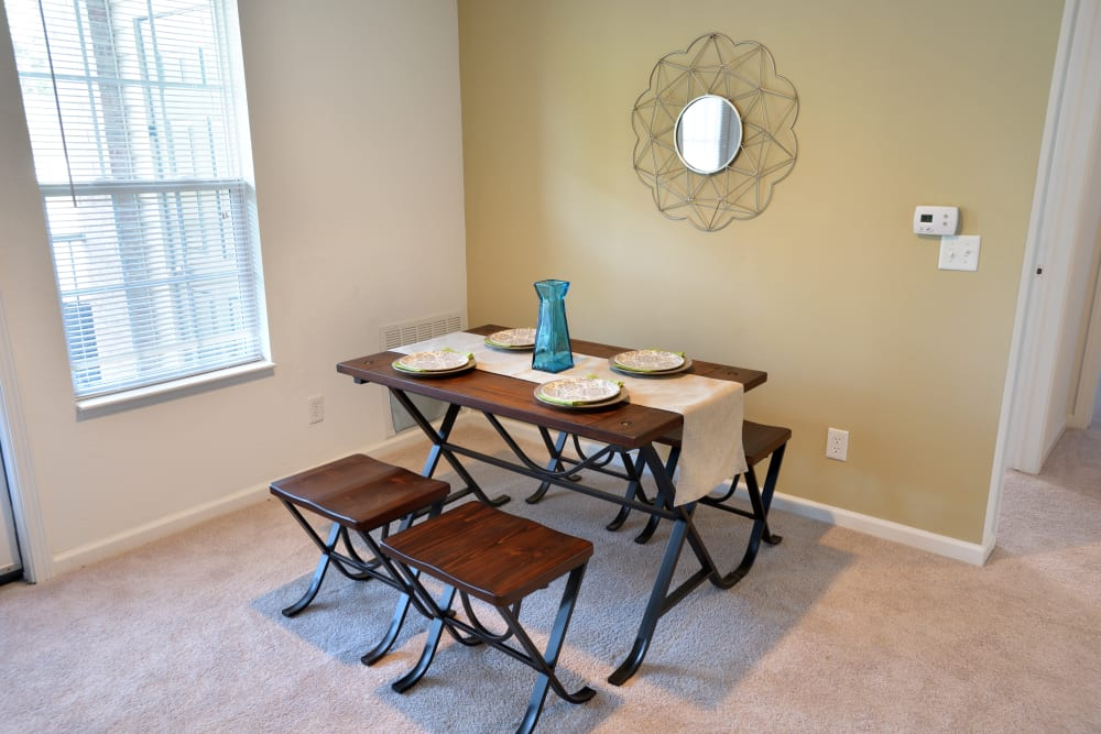 Dining room table in model home at Cascade Falls Apartments in Akron, Ohio