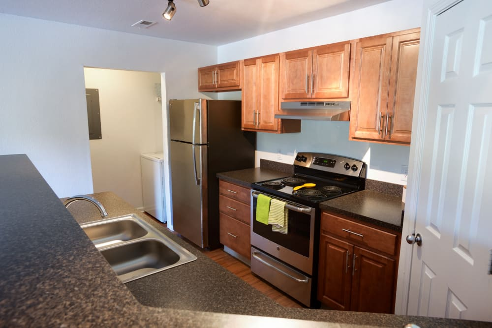 Stainless steel appliances in kitchen at Cascade Falls Apartments in Akron, Ohio