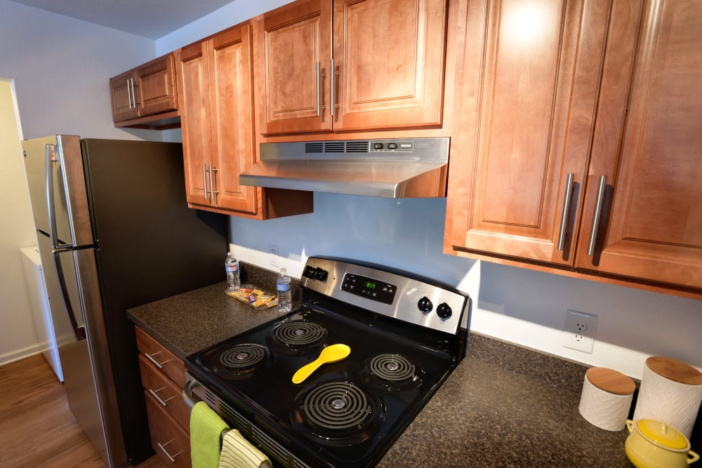 Kitchen stove in model home at Cascade Falls Apartments in Akron, Ohio