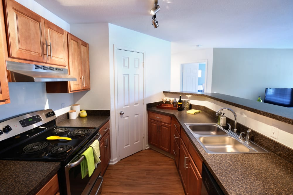 Beautiful kitchen in model home at Cascade Falls Apartments in Akron, Ohio