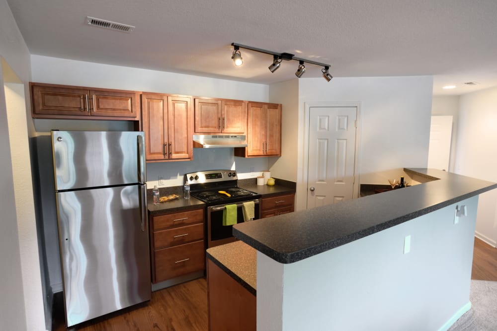Open kitchen in model home at Cascade Falls Apartments in Akron, Ohio