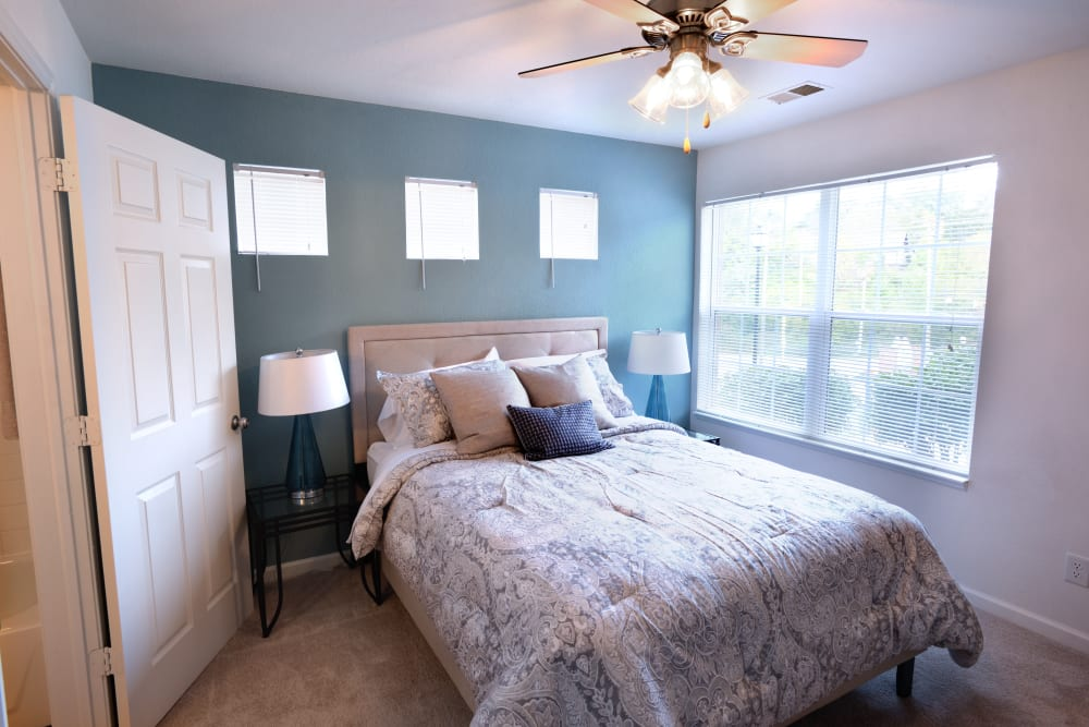 Master bedroom in model home at Cascade Falls Apartments in Akron, Ohio
