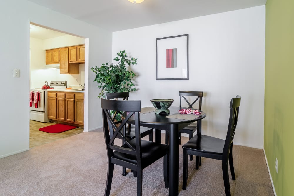 Dining table with view of kitchen at Edgewood Park Apartments in Pontiac, Michigan