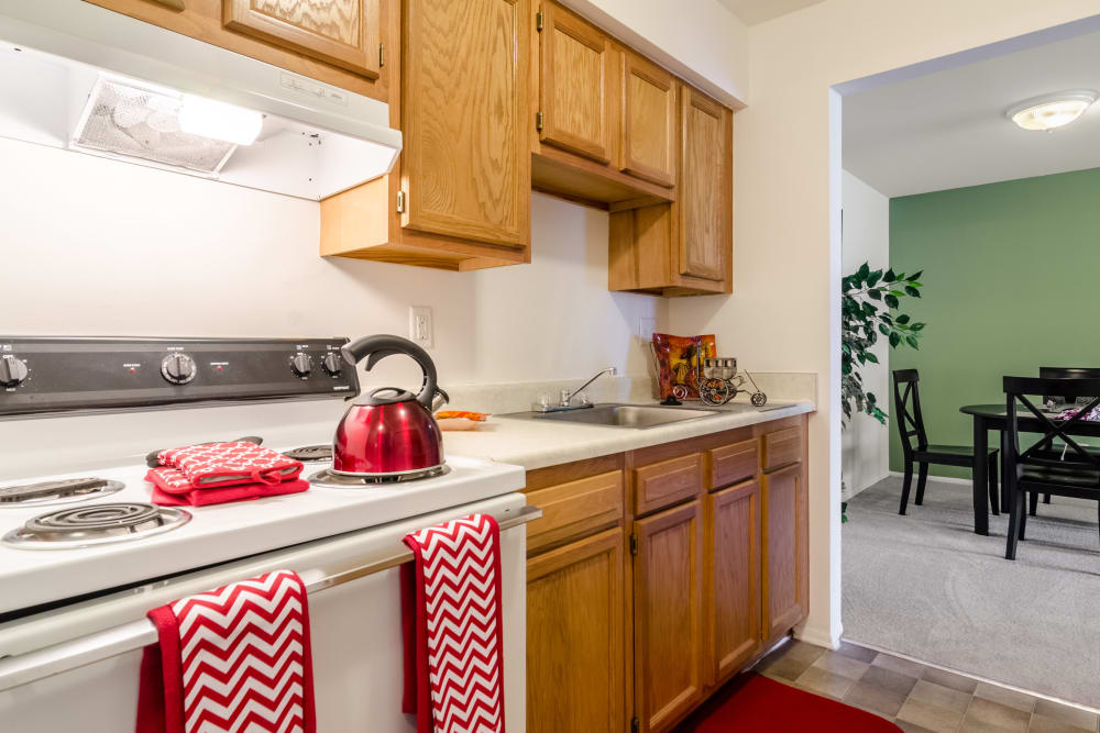 Kitchen model with red kettle at Edgewood Park Apartments in Pontiac, Michigan
