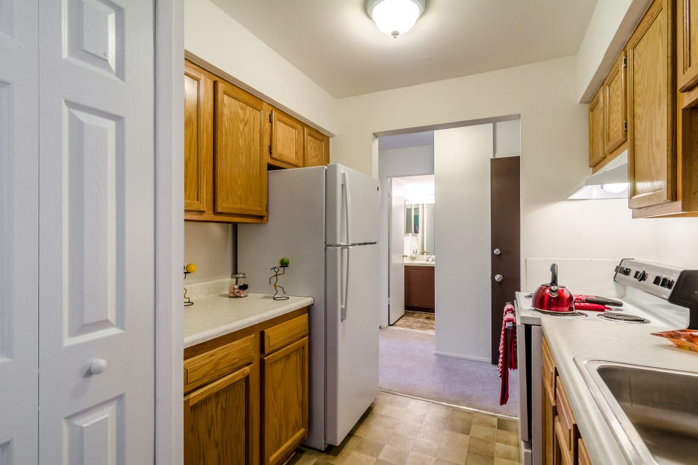 Kitchen with wood cabinets at Edgewood Park Apartments in Pontiac, Michigan