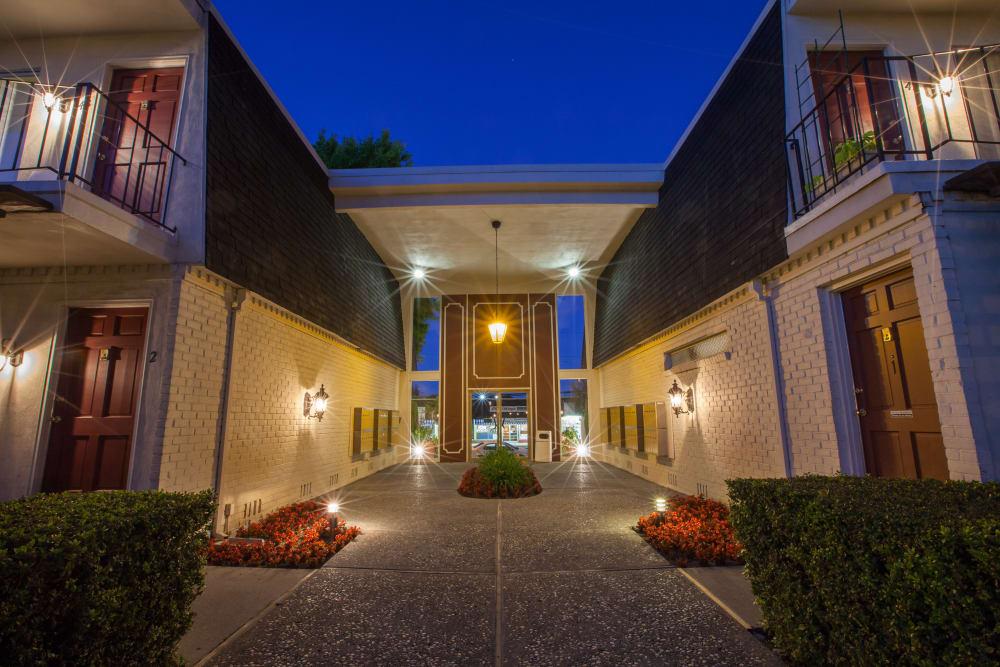 Exterior of Normandy Park Apartments' building at night in Santa Clara, California