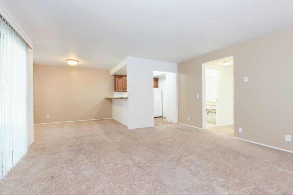 Spacious living area with carpet at Normandy Park Apartments in Santa Clara, California