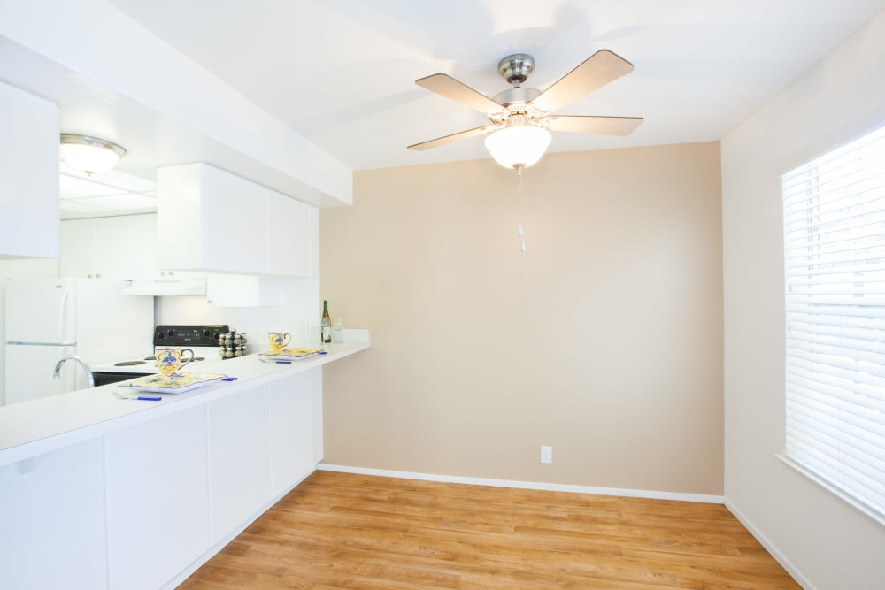 Dining area with a ceiling fan at Normandy Park Apartments in Santa Clara, California