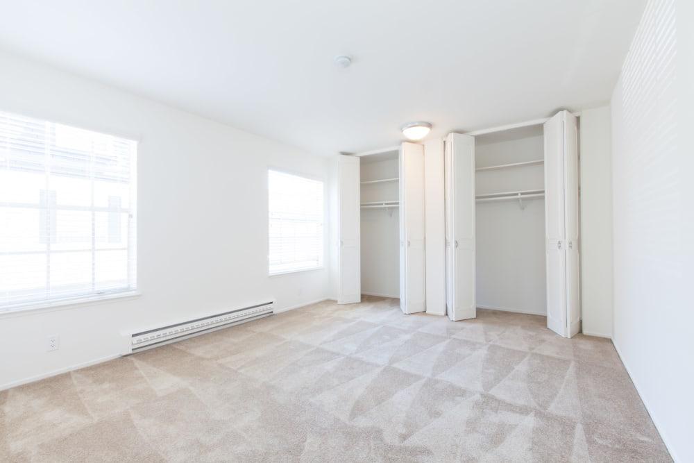 Master bedroom with large closets at Normandy Park Apartments in Santa Clara, California
