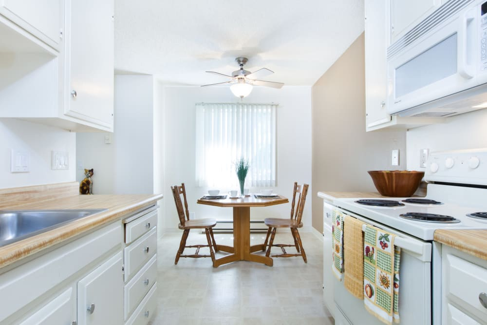 Bright dining area at Oak Pointe Apartments in Fremont, California