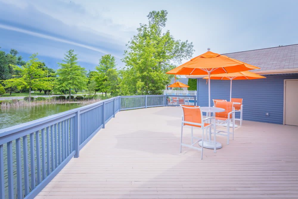Patio with furniture at Waters Edge Apartments in Lansing, Michigan