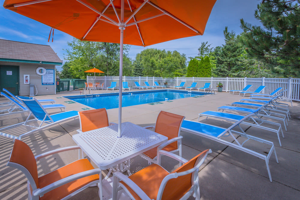 Blue and orange patio furniture at Waters Edge Apartments in Lansing, Michigan