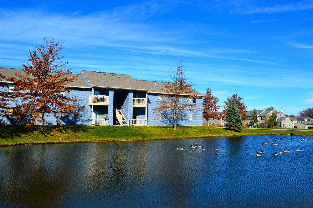 Exterior by the lake at Waters Edge Apartments in Lansing, Michigan