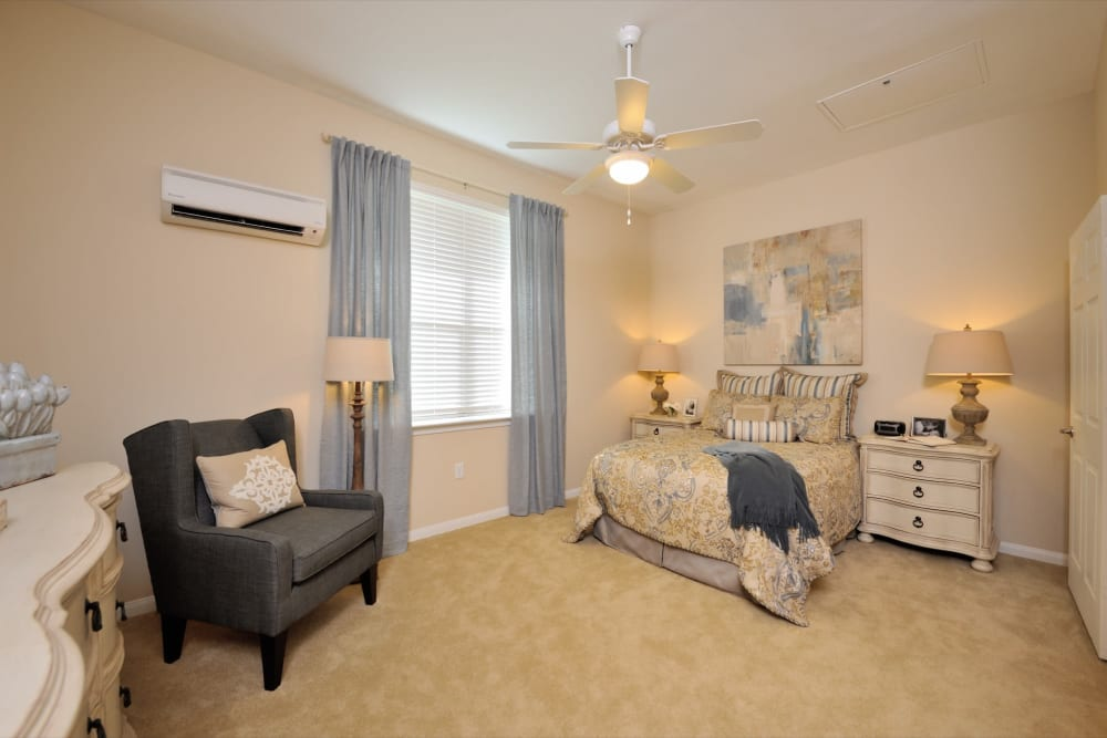 A decorated apartment bedroom at Clayton Oaks Living in Richmond, Texas