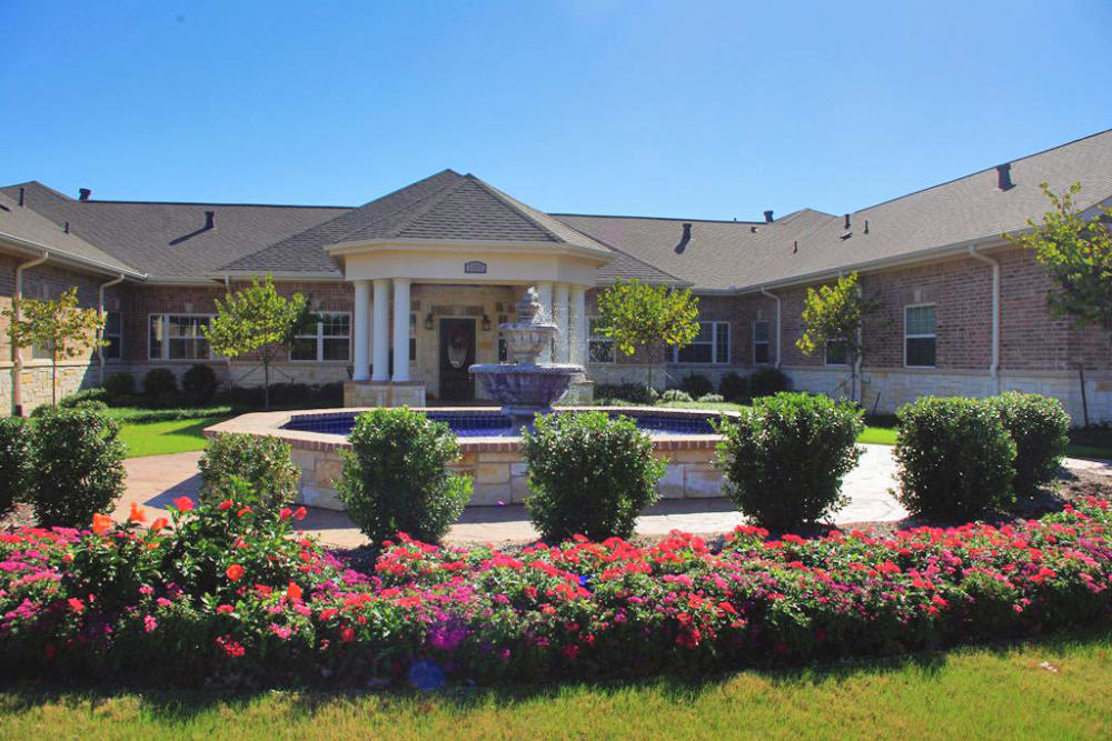 Beautiful landscaping outside of The Village at Valley Creek in Denton, Texas