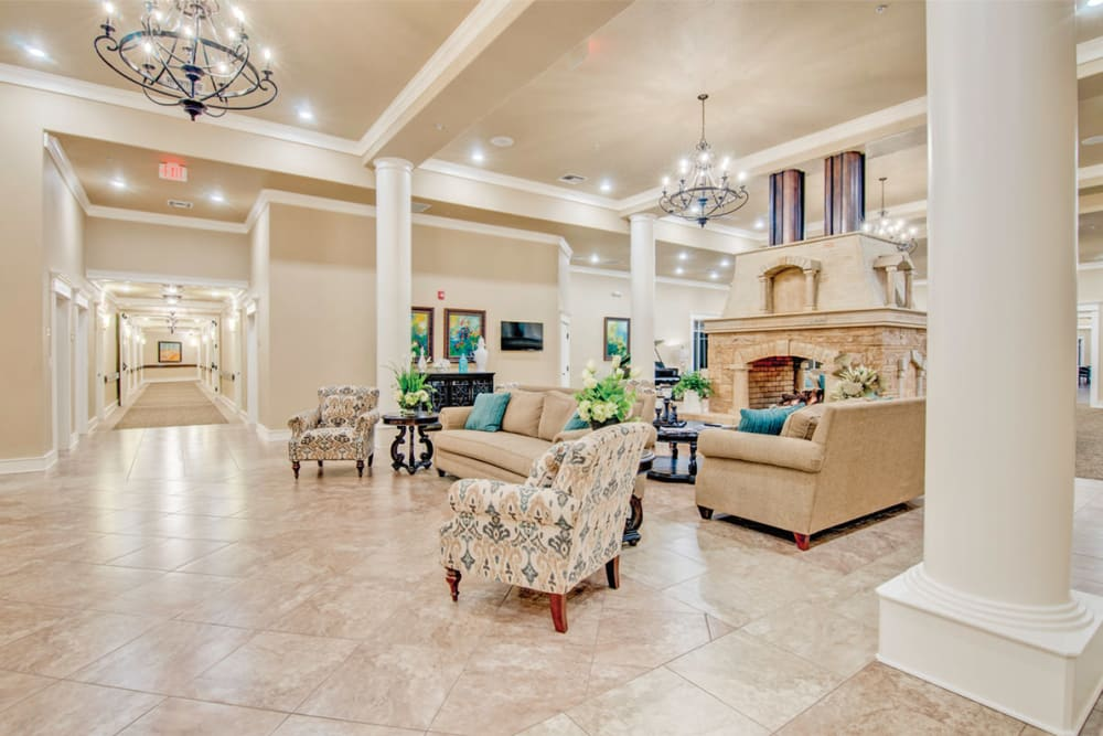 Tile flooring and community seating in the main lobby at Village on the Park Bentonville in Bentonville, Arkansas
