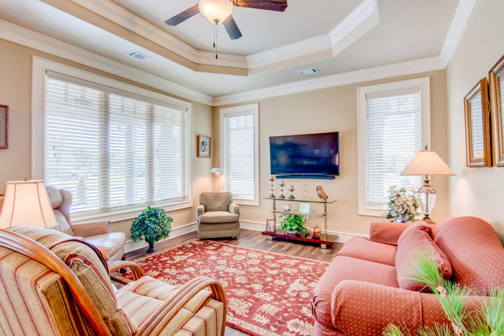 Wood flooring in a decorated cottage living room at Village on the Park Bentonville in Bentonville, Arkansas