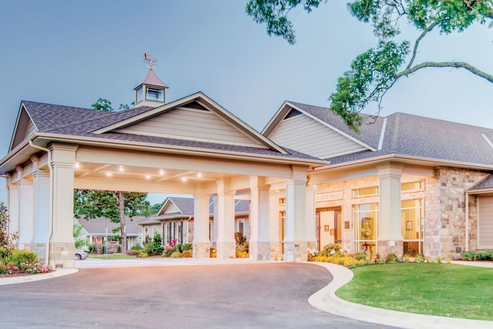 The driveway and main entrance at Village on the Park Bentonville in Bentonville, Arkansas