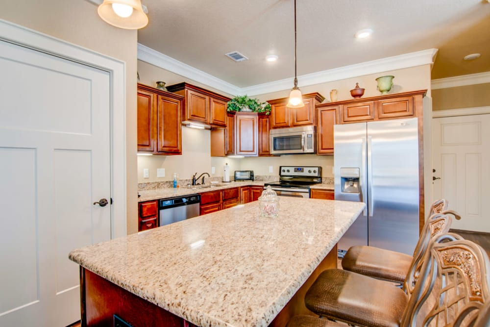 Granite counter tops in a cottage kitchen at Village on the Park Bentonville in Bentonville, Arkansas