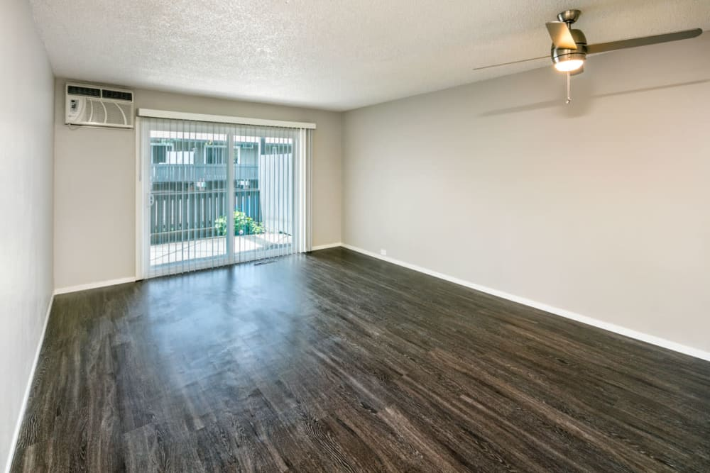 Living room with wood-style flooring at 1038 on Second in Lafayette, California